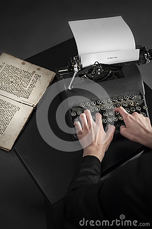 Old typewriter and an ancient manuscript