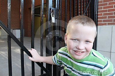 Autistic Boy At a Locked Gate