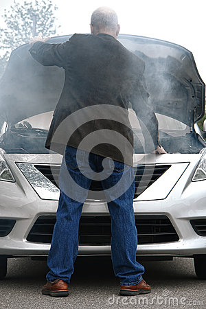 Auto Driver and Open Car Engine Hood in Fire Smoke