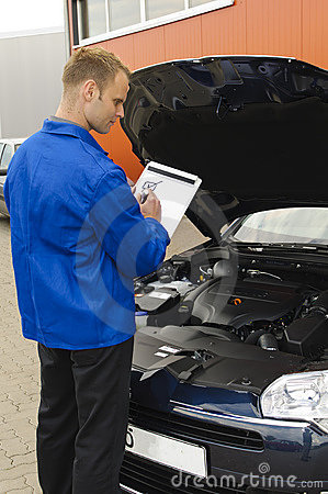 Auto mechanic checks a vehicle