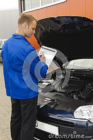 Auto mechanic checks a vehicle