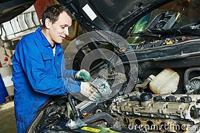 mechanic repairing automobile car engine turbine at maintenance repair