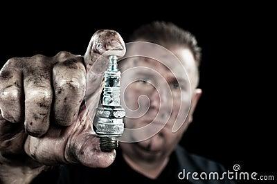 Auto mechanic and sparkplug