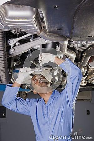 Free Auto Mechanic Under Car Stock Photography - 4016162