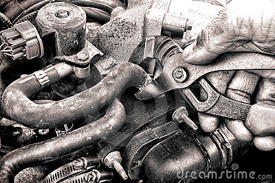 Auto Repair Mechanic Hand Fixing a Car Engine Part