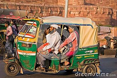 Auto rickshaw driving on road,India Editorial Stock Photo