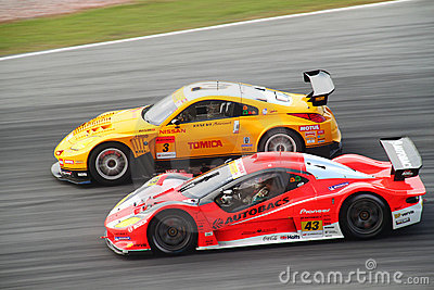 Autobac 43 and Hasemi 3, SuperGT 2010 Editorial Stock Photo