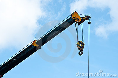 Automobile crane with blue sky.