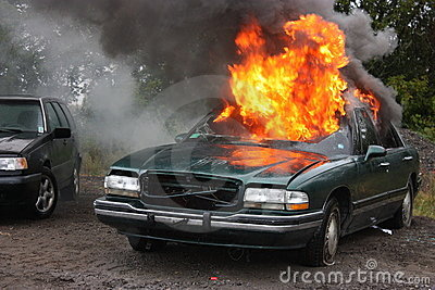 An automobile engulfed in fire.