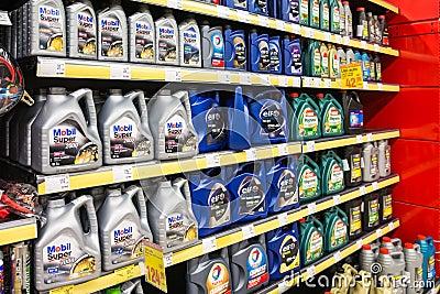 Automobile Motor Oil On Supermarket Shelf Editorial Stock Image