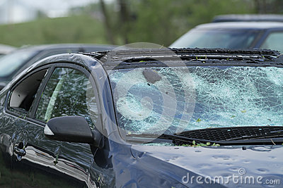 Automobile ruined by  hail storm Editorial Image
