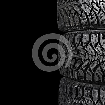 Automobile tire on black