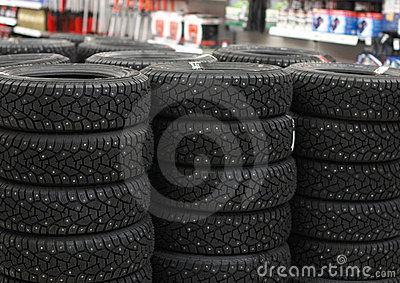 Automobile tyres in a supermarket