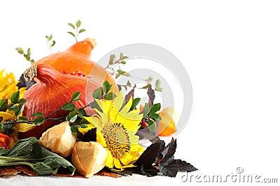 Autumn arrangement with pumpkins and sunflowers