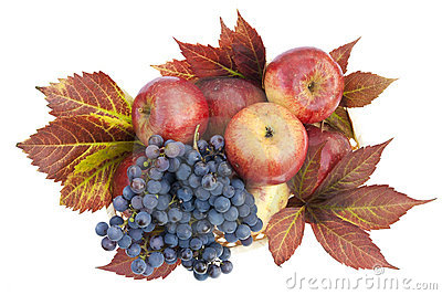 Autumn background from apples and grapes