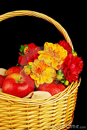 Autumn basket with apples and flowers