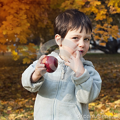 Autumn child with apple