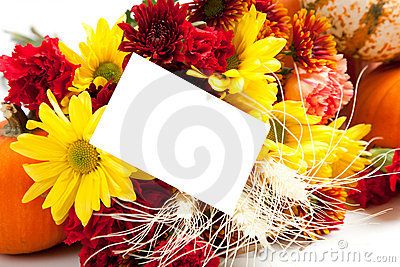 Autumn floral arrangement on white with a note