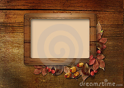 Autumn frame on wooden background