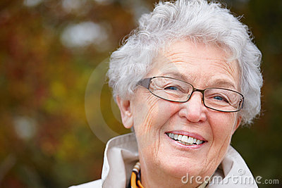 Autumn - Friendly older woman with copyspace
