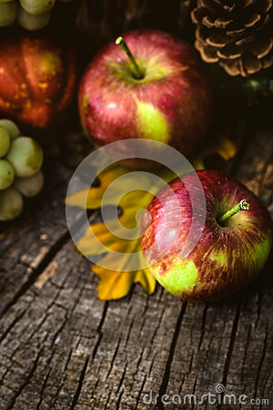 ... concept. Fall fruit and vegetables on wood. Apples and grapes on wood