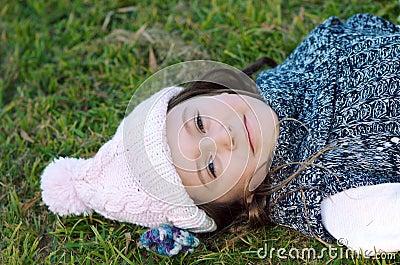 Autumn girl lying in grass