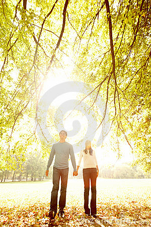 Autumn - Happy young couple walking together