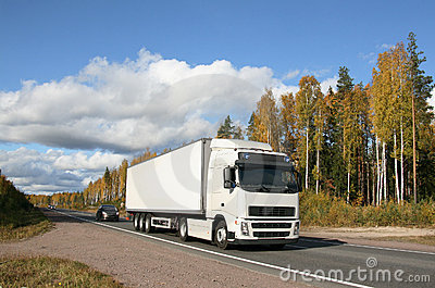 Autumn highway and white truck