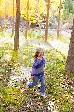 Autumn kid girl running poplar tree forest motion blur
