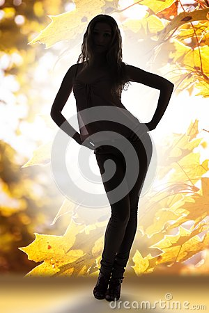Autumn lady over golden leaves background