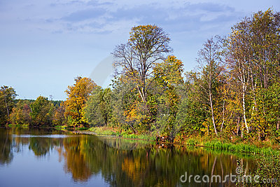 Autumn landscape with calm lake