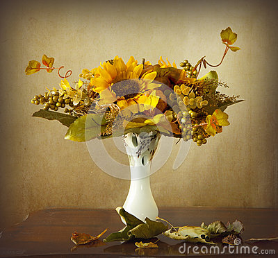 Autumn leaves and dried sunflowers