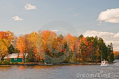 Autumn leaves and lake cabin