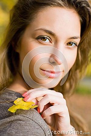 Autumn park and a beautiful brunette.