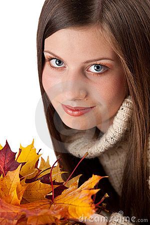 Autumn portrait of beautiful woman with leaf