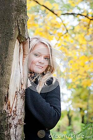 Autumn portrait of blonde girl