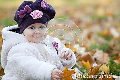 Autumn portrait of a little girl