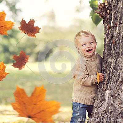 Free Autumn Portrait Of Happy Child Playing Having Fun With Flying Yellow Maple Leaves Royalty Free Stock Photo - 99232145