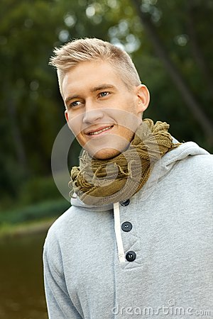 Autumn portrait of young blonde man