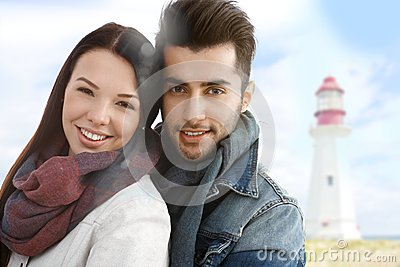 Autumn portrait of young couple on the beach