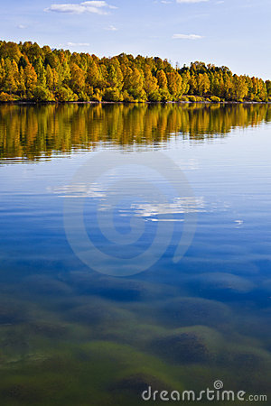Autumn shoreline with beautiful clouds