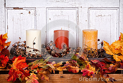 Autumn still life with candles and leaves