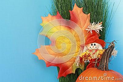 Autumn still life with leaf, scarecrow, pumpkin