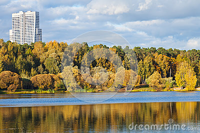 Autumn urban park on river bank afternoon