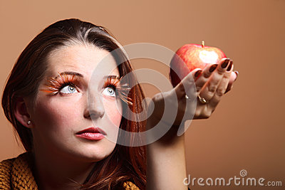 Autumn woman red apple fresh girl glamour eye-lashes