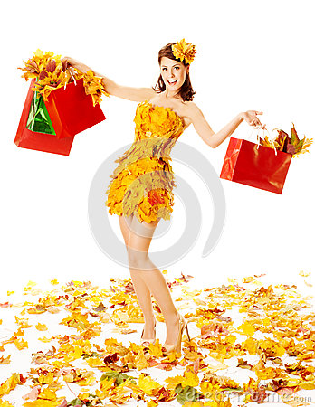 Autumn woman with shopping bags in dress of maple . White background