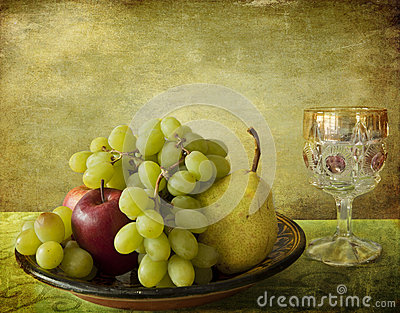 Autumnal fruits and glass