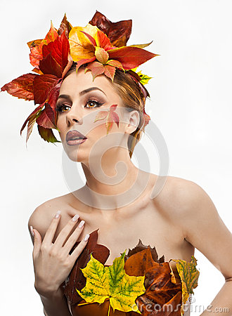 Autumnal woman. Beautiful creative makeup and hair style in fall concept studio shot. Beauty fashion model girl with fall makeup