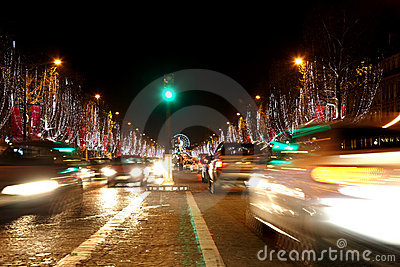 Avenue des Champs Elysees at night. Stock Photo