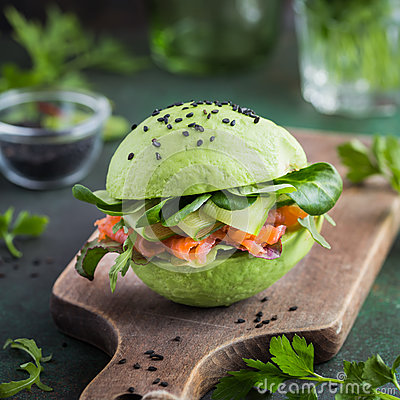 Free Avocado Burger With Salted Salmon And Fresh Vegetables. Royalty Free Stock Photo - 92175355